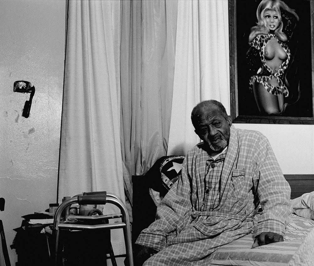 LaToya Ruby Frazier, <em>Gramps On His Bed</em> from the series <em>Notion of Family</em>, 2003, gelatin silver print, 50.8 cm x 60.96 cm