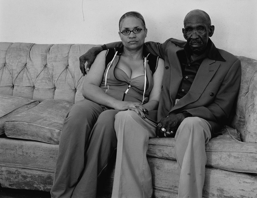 LaToya Ruby Frazier, <em>Mom and Her Friend Mr. Yerby On His Couch</em> from the series <em>Notion of Family</em>, 2005, gelatin silver print, 50.8 cm x 60.96 cm
