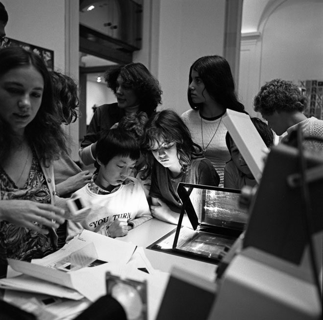 Participants using the Xerox 6500 copier during a workshop at the exhibition, 1976.