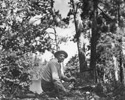 Arthur Lismer (Canadian, 1885 – 1969), The artist sketching in the bush, Lake Temagami, August 1944, photographic print.