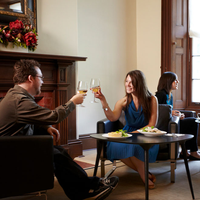 couple toasting with white wine in Members' Lounge