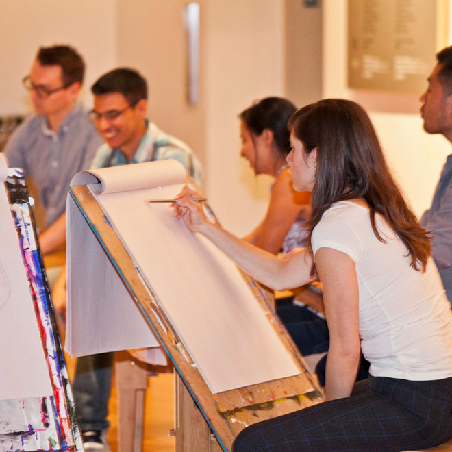 group drawing at easels in Walker Court