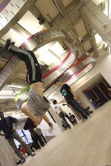 BBoy Anansi/Tafiya and Pablo break-dancing in the AGO's Weston Family Learning Centre
