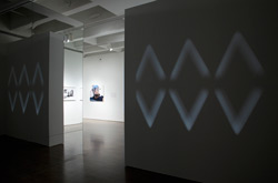 Annie MacDonell, installation view: <em>Fade/Wipe/Dissolve</em>, 2012, 16mm film, black and white, silent, 2:36 mins.
