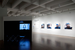 Emmanuelle Léonard, installation view:<br /> R: <em>Citizens, protest, March 15, 2009</em>, 2009, 102 cm x 90 cm inkjet prints.<br /> L: <em>On Beauty and Ugliness and Photography</em>, 2011, video (colour, sound, 16:20 mins.).