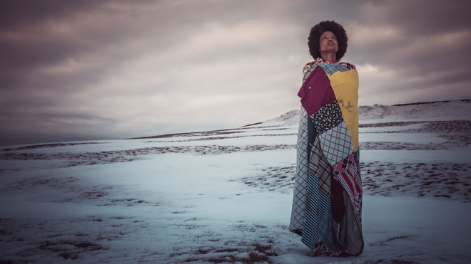 Shauntay Grant photographed at Citadel Hill in Halifax, wrapped in Winter Quilt