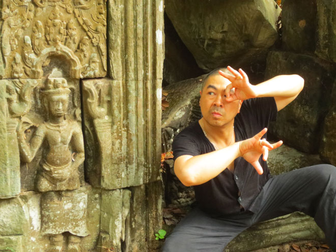 Peter Chin dances in the Angkorian temple ruins of Banteay Kedei in Cambodia