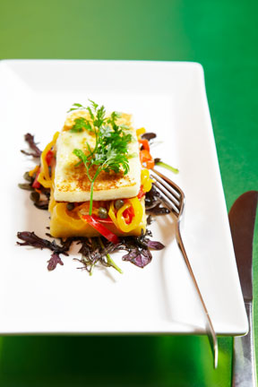 Pan seared halloumi cheese on crisp polenta