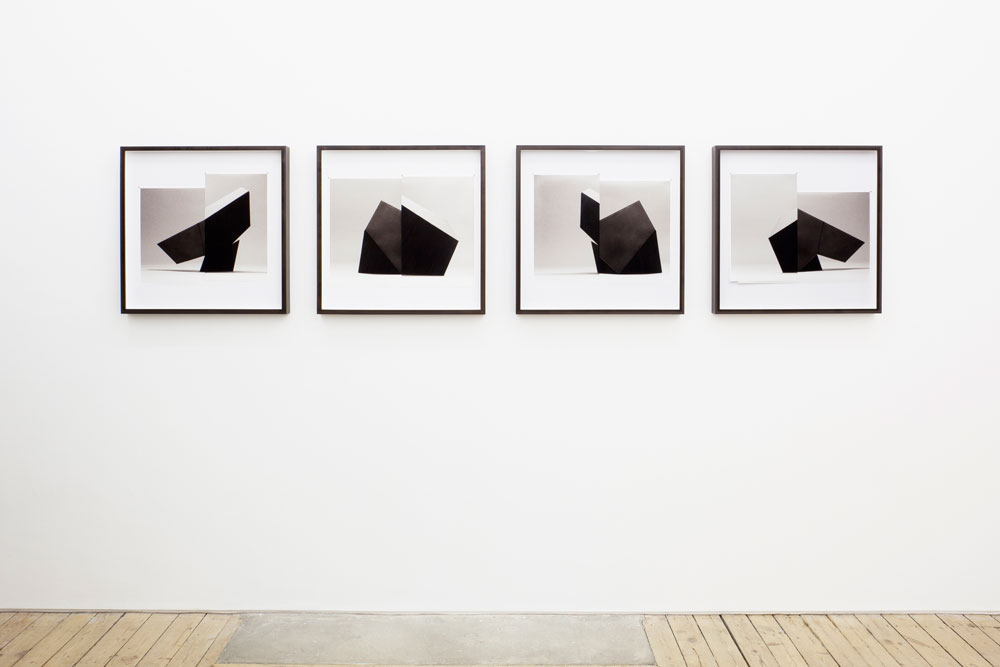 Erin Shirreff, installation view: <em>Four Sides (Proof)</em>, 2011, four parts: Archival pigment prints, pins, artist frames, prints pinned to 60.9 cm x 60.9 cm mats, The approach, London, U.K.<br /> Photo by Plastiques Photography.