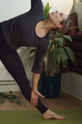 Woman doing yoga triangle pose