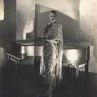 Marion Morehouse wearing a dress by Chéruit and jewelry by
